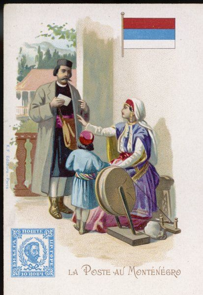 A postman of Montenegro brings a letter to a housewife as she sits at her spinning wheel