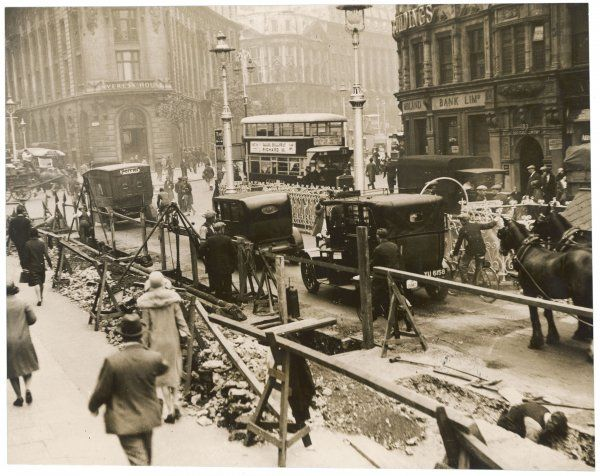 Traffic, including both horses and carts and motor cars, on Waterloo Bridge