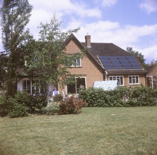 Solar panels on the roof of a suburban dormer bungalow. Date: 1978