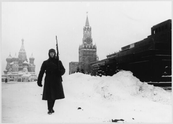 A Russian sentry on guard duty near Lenin's tomb in the snow- covered Red Square, Moscow