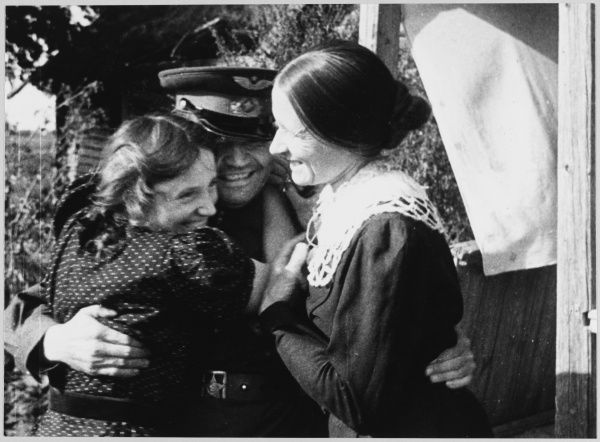 LIBERATION SCENES A Soviet soldier is greeted in a liberated village
