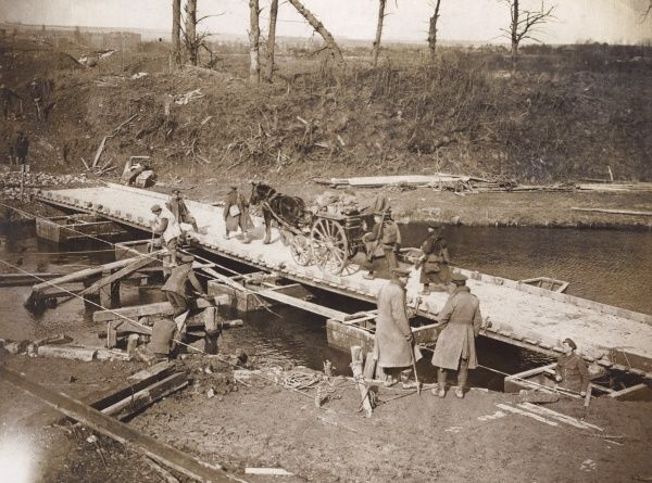Soldiers of the Royal Engineers building a pontoon bridge near Boesinghe, Flanders, during the First World War. Date: 1914-1918