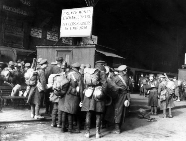 Soldiers with their kit, on leave at a railway station (possibly a London terminus), during the First World War