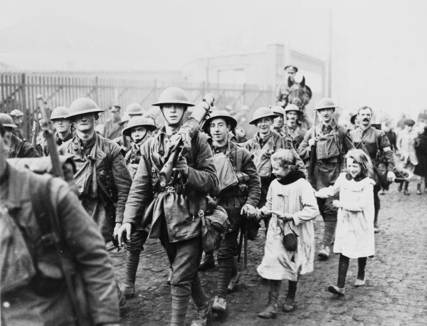 British soldiers greeted by children in Lille on the Western Front in France during World War I in 1918