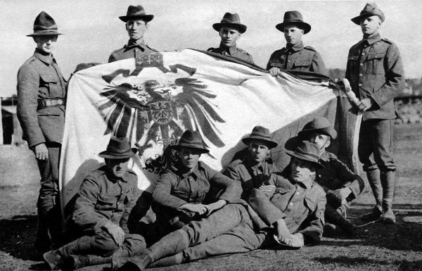 Soldiers from the New Zealand Expeditionary Force posed with the captured Imperial German Standard