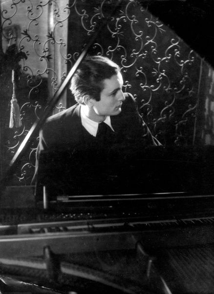 A moody pianist in gothic surroundings. Date: 1930s