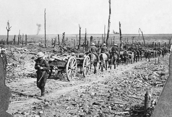 A British convoy of ammunition carriages make their way through the desolate landscape of the Somme