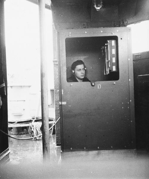French soldier listening in a sonar station to detect enemy submarines during World War II