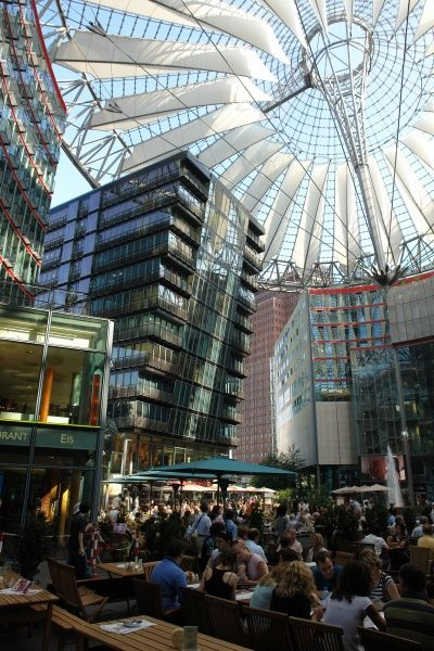 View of the Sony Centre at the Potsdamer Platz, Berlin, Germany, with people sitting at tables