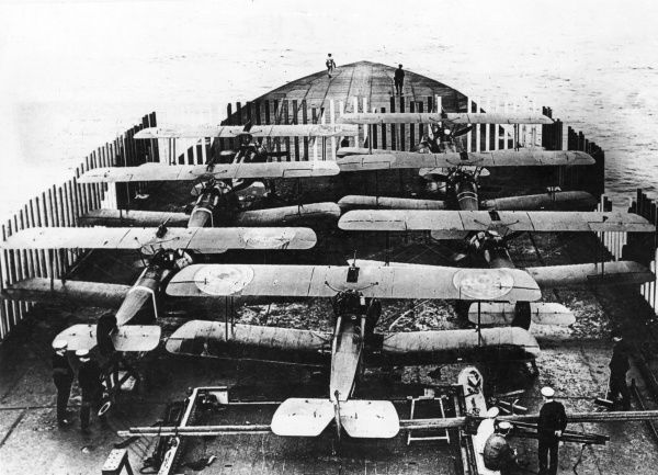 Sopwith biplanes on the deck of the aircraft carrier HMS Furious (a modified Courageous-class cruiser) during the First World War. Launched in 1916, HMS Furious served in both World Wars and was scrapped in 1948. Date: 1916-1918