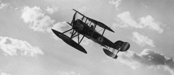 A Sopwith Baby seaplane in flight during the First World War. It was a British single-seater tractor seaplane used by the Royal Naval Air Service (RNAS) from 1915. Date: 1915-1918
