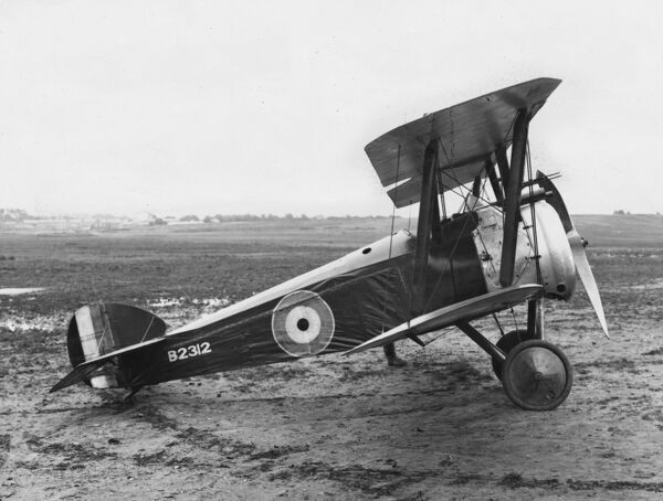 A British Sopwith F1 Camel fighter biplane on an airfield during the First World War. Date: 1918