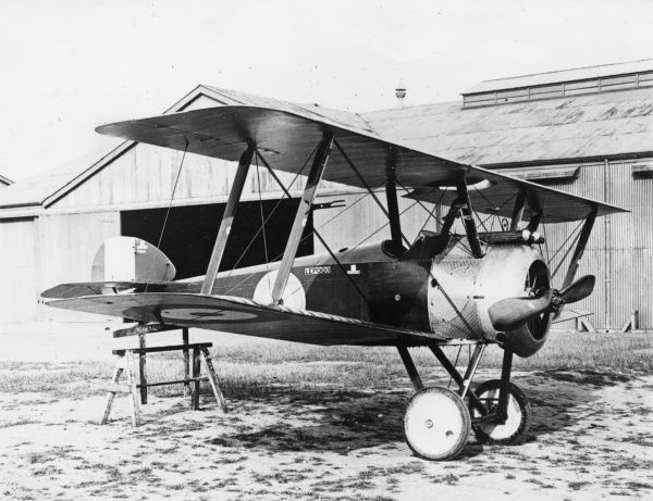 A British Sopwith F1 Camel fighter biplane on an airfield during the First World War. Date: 1917-1918