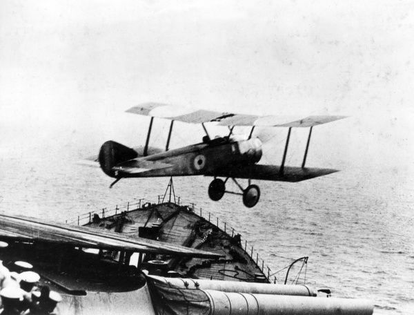 A Sopwith Pup biplane taking off from the B turret of HMS Repulse during the First World War. Date: October 1918