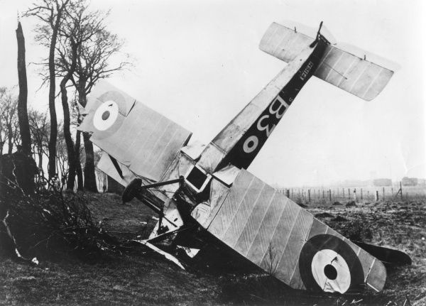 A Sopwith 1 Strutter biplane of No. 5 (N) Squadron RNAS (Royal Naval Air Service) which has crashed at Petite-Synthe airfield, Dunkirk, northern France, during the First World War. Date: 1917