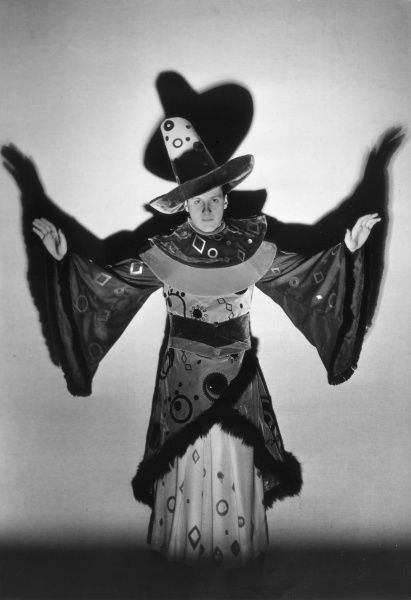 A rather camp Sorcerer's costume, in brown and yellow velvet! Date: 1930s