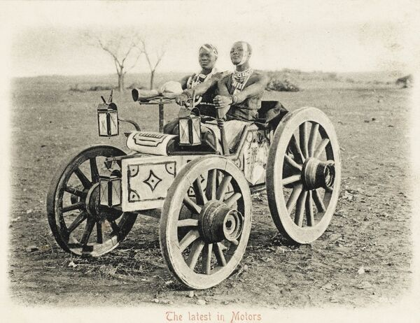 A 'humourous' card depicting two Zulu warriors on a vehicle manufactured by the 'Zulu Motor Company' !