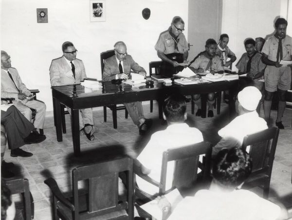 Officials standing to speak on the panel of the Annual General Meeting of the South Arabian Boy Scouts Association in Aden