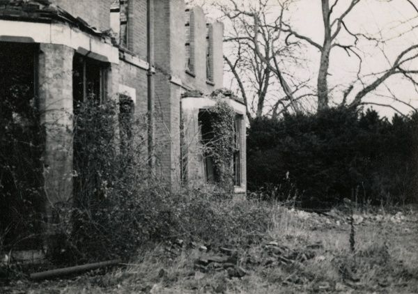 Photograph of the south east face of Borley Rectory taken from the south. The photograph, taken on 28 March 1939, shows the aftermath of the fire of 27 February 1939. HPG/1/3/5 (xxiv)