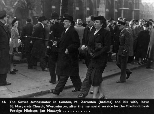 The Soviet Ambassador in London, M. Zaroubin (hatless) and his wife, leave St. Margaret's Church, Westminster, after the memorial service for the Czecho-Slovak Foreign Minister, Jan Mazaryk