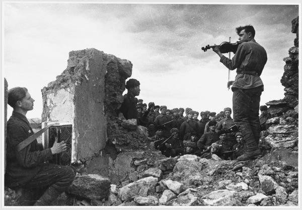 A musical interlude for Soviet soldiers amoung the ruins. Soldiers play the accordion and the violin