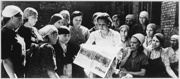Soviet women read Pravda on the day the Anglo-Soviet Agreement is announced
