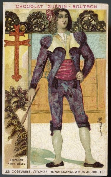 A young Spanish man dressed in bullfigher costume: a short jacket, red cummerbund, breeches, and black slippers