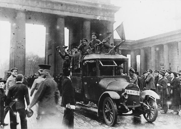 Left wing revolutionaries in a car with a mounted machine gun, in front of the Brandenburg Gate in Berlin, Germany, during the Spartacus Uprising, c. December 1918