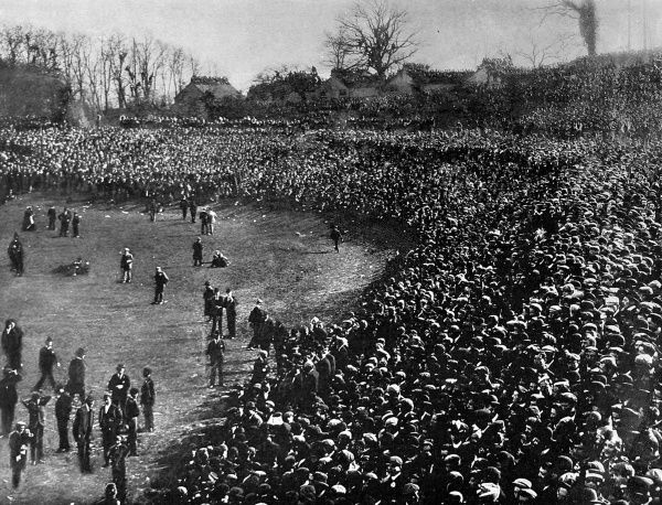 Photograph showing a section of the crowd assembled to watch the 1901 F.A. Cup Final, at Crystal Palace, between Tottenham Hotspur and Sheffield United. Officially, 114,000 supporters gathered to watch the match although this might not include those seen