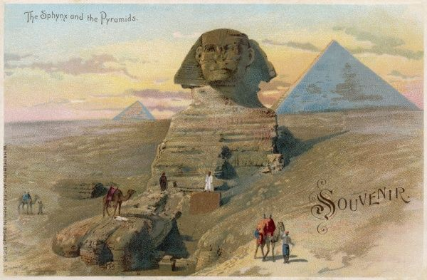A view of the Sphinx, with the pyramids of Giza in the background