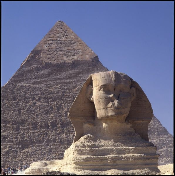 The SPHINX, with the CHEPHREN PYRAMID behind it, Giza near Cairo - Egypt