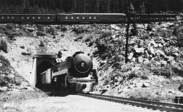 Lower portal of 'Number Two' tunnel, Spiral Tunnels, Field, British Columbia, Canada. The locomotive is passing under the train it is pulling! The tunnel opened in 1909