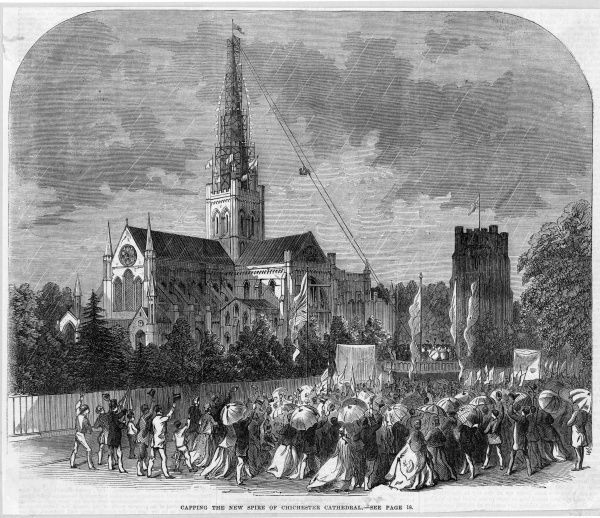 The good folk of Chichester, West Sussex, gather to watch the spire of their cathedral getting capped