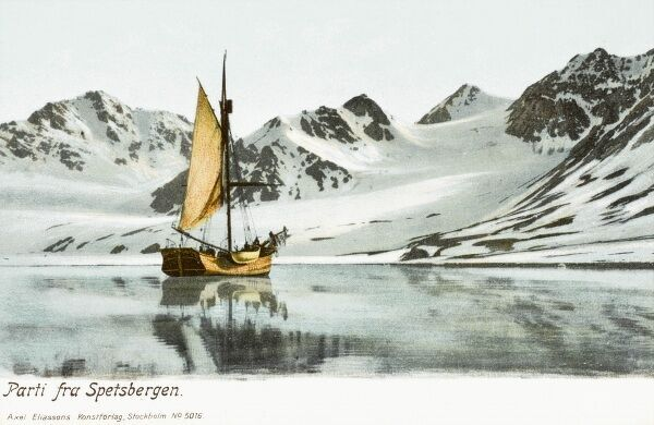 A large sailing vessel off the coast of Spitzbergen a northerly Norwegian Island in the Arctic Ocean - The lack of ice on the water indicates that this is likely to be in the summer