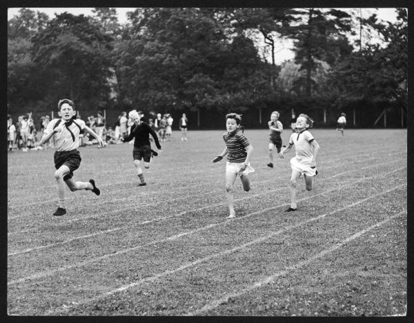 Determined-looking boys compete against one another in a race