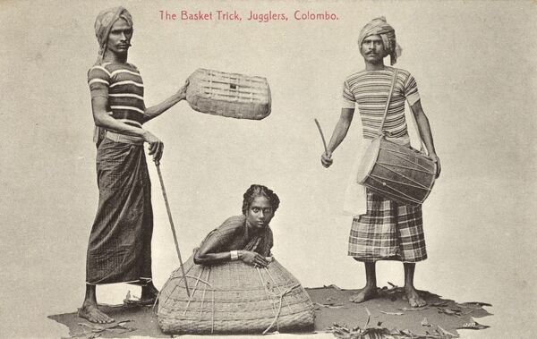Sri Lanka - Basket Trick - Conjurers (called 'jugglers' on the card) place a woman inside a large wicker basket from whence she would (I imagine) disappear, much to everyone's surprise! Date: circa 1907
