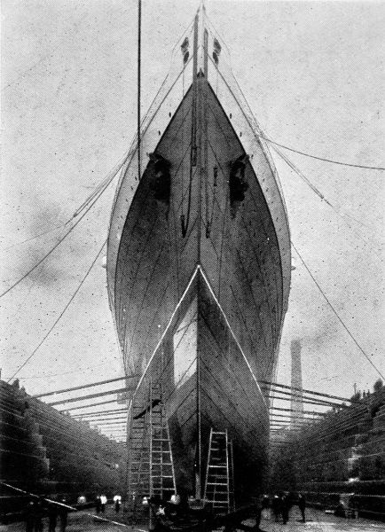 Photograph of the bows of the Cunard Liner, SS 'Lusitania', in dry dock 1907. 'Lusitania' was then the largest liner afloat, weighing 32,500 tons and capable of twenty-six knots