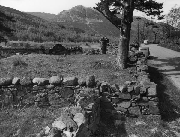 The ruins of St. Bride's (or St. Bridget's) Chapel, near Callender, Perthshire, Scotland, with Ben Ledi in the background. Date: 1950s