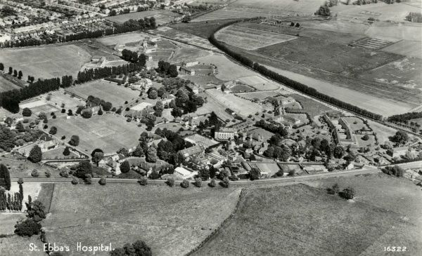 Aerial view of St Ebba's Hospital, on Hook Road, near Epsom in Surrey. It was originally opened by the London County Council in 1903 as the Ewell Epileptic Colony. It later became known as Ewell Mental Hospital and then as St Ebba's Hospital
