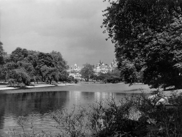 A delightful view across the lake in St. James's Park, central London. Date: 1930s