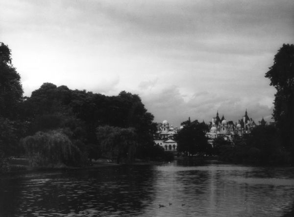 Looking across the lake in St. James's Park, central London, towards the Horse Guards Parade building. Date: 1930s