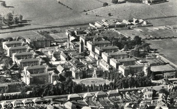 Aerial view of St Lawrence's Hospital at Caterham in Surrey, originally opened in 1870 by the Metropolitan Asylums Board as an 'imbeciles asylum' for London's sick poor suffering from mental conditions such as epilepsy and severe