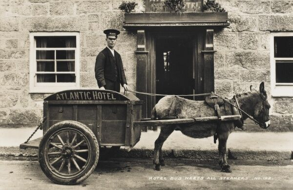 St Marys Island, Isles of Scilly - The Atlantic Hotel - Donkey Cart used to transport your baggage from the harbour up to the hotel. The cart is rather wonderfully labelled a 'bus' !! The driver has a very important and shiny cap!