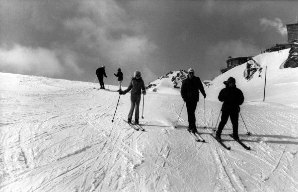 Fashionable skiers on the slopes above St. Moritz, Switzerland. Date: 1960s