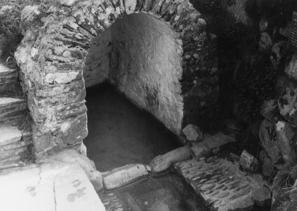St. Non's Well, said to have sprung up during a thunderstorm when St. David was born. Its waters are said to cure infirmities, Pemrokeshire, Wales. Date: 500 A.D