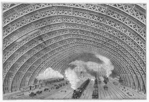 The interior of the station, showing the magnificent canopy dwarfing the trains beneath
