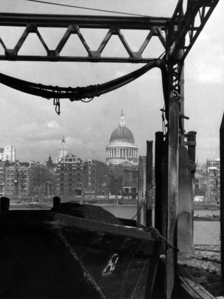 A fine industrial riverside view of St. Paul's Cathedral, from Bankside, London. Date: 1930s