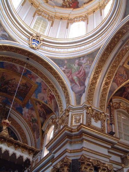 A view up to the elaborately decorated ceiling of the St Peter and St Paul Cathedral, Mdina, Malta