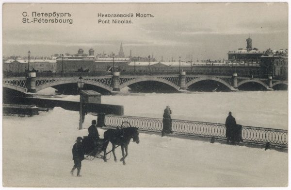 The city in winter : a horse- drawn sleigh beside the frozen Neva : behind is the Nicolai Bridge