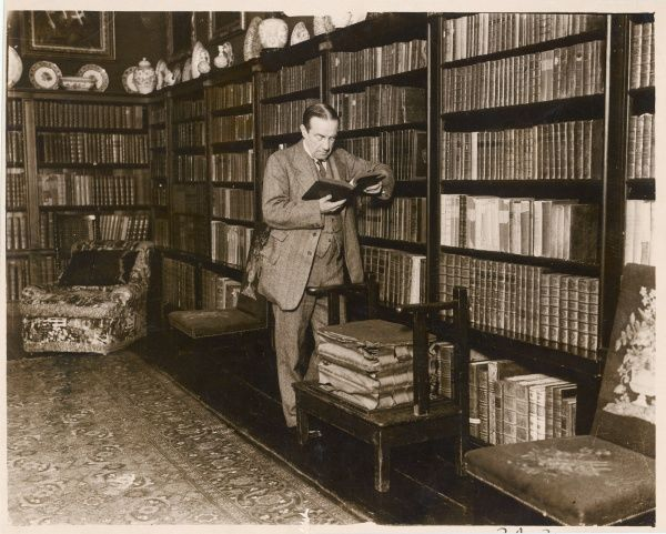 The English politician Stanley Baldwin reading in his library